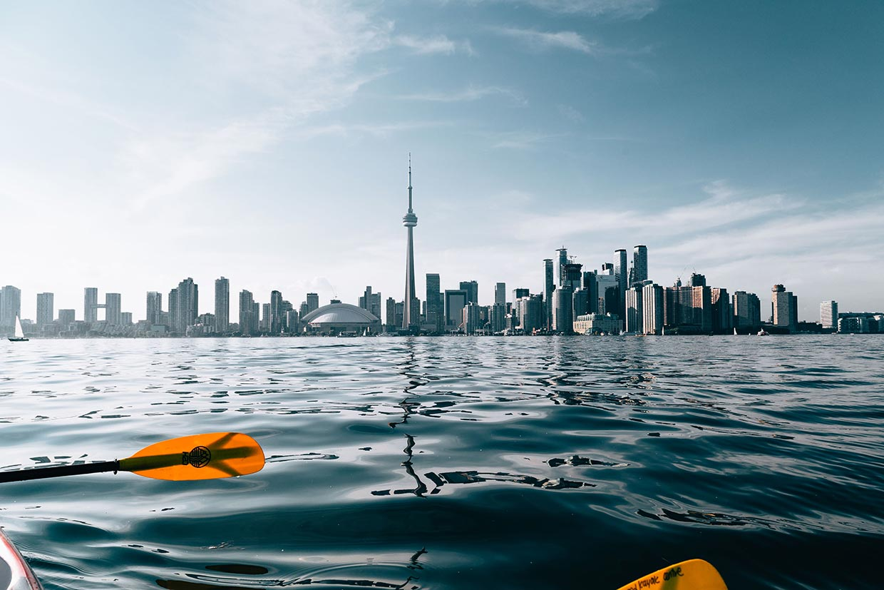 A perfect view of the Toronto city skyline as seen from the seats of a kayak.