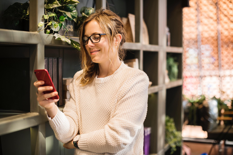 freelancer using social media on smartphone