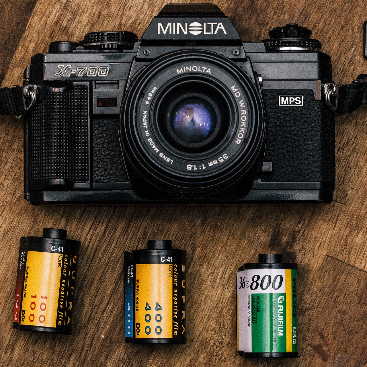 minolta film camera with rolls of film