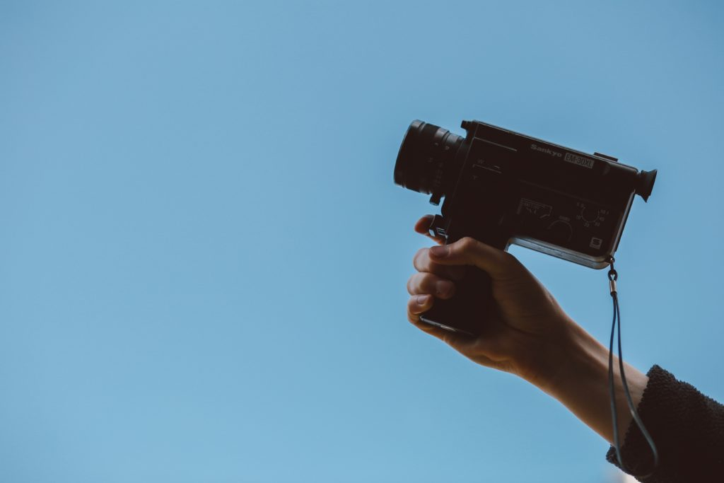 person holding super 8 camera