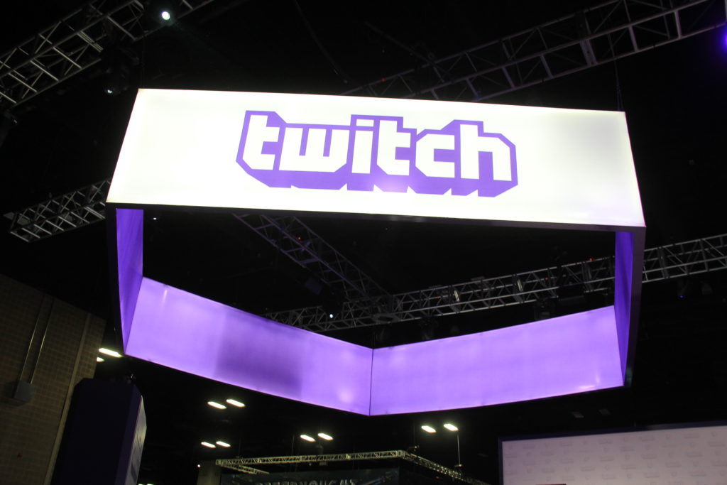 white and purple twitch sign at PAX event