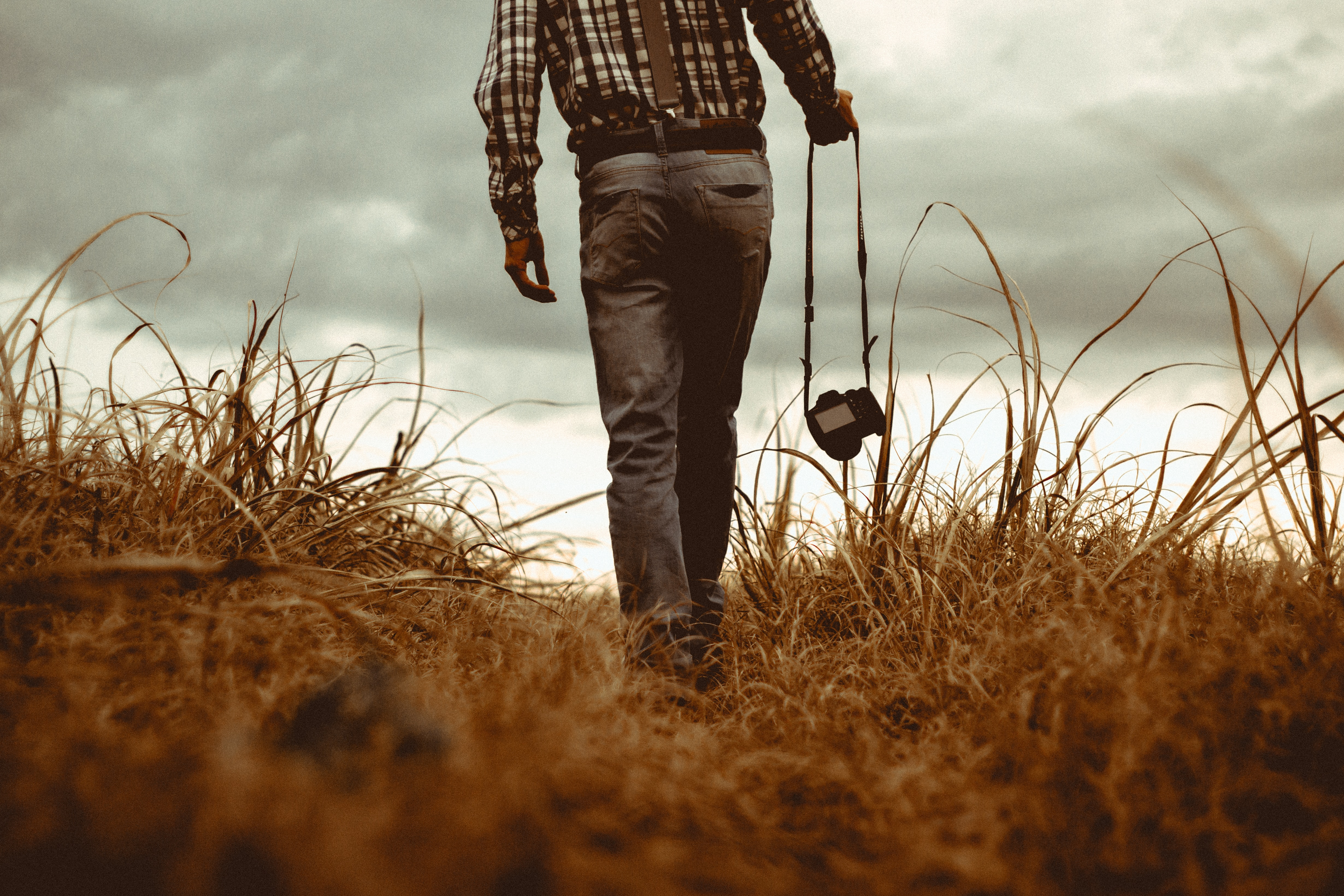 man walking with camera vintage