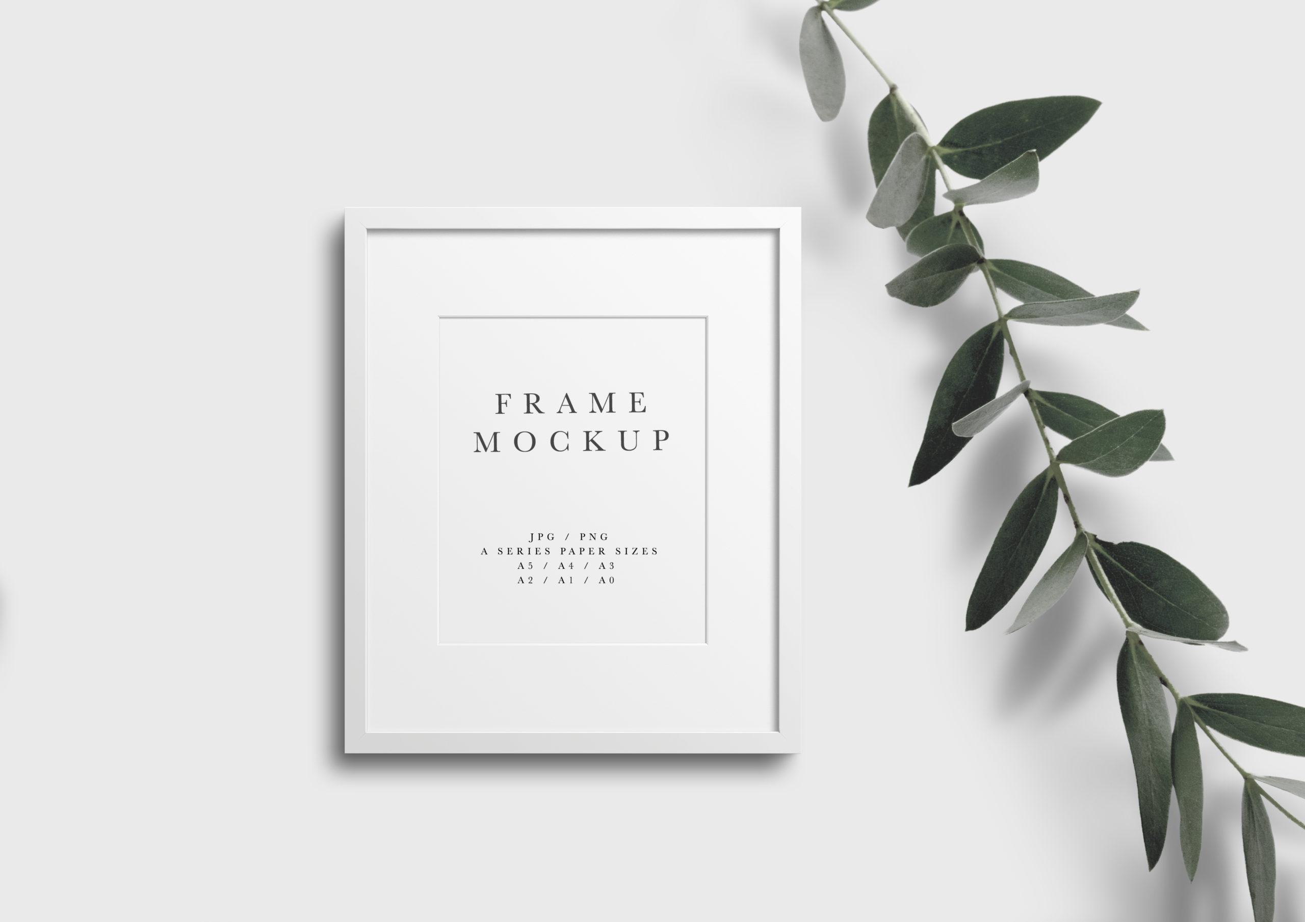 styled white frame photo mockup with minimal leaves