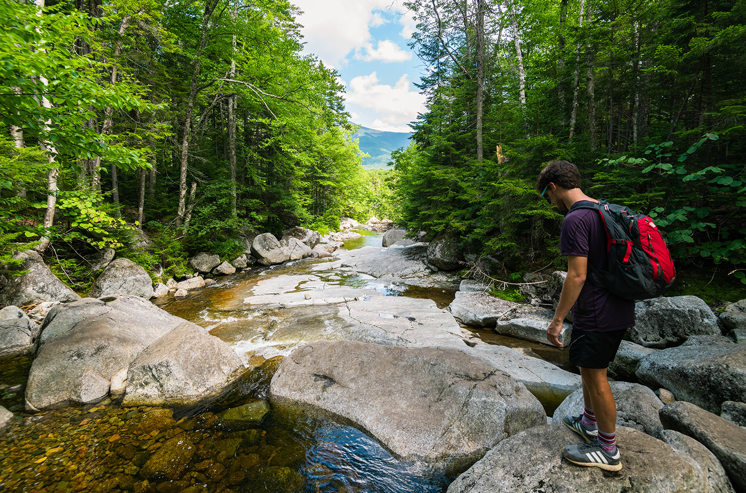 man hiking New Hampshire river mountain forest