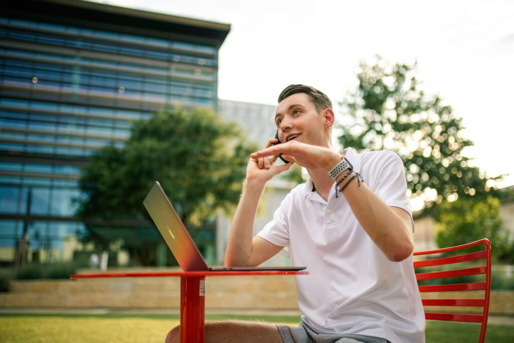 man talking on phone outside