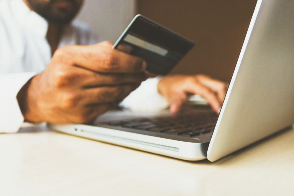 man paying online with credit card