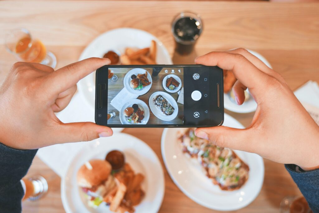 user-generated content person taking photo of food with phone