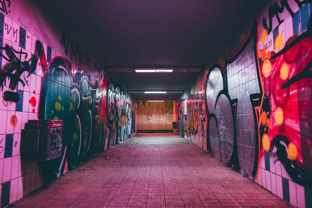 grungy street photo pink neon graffiti corridor
