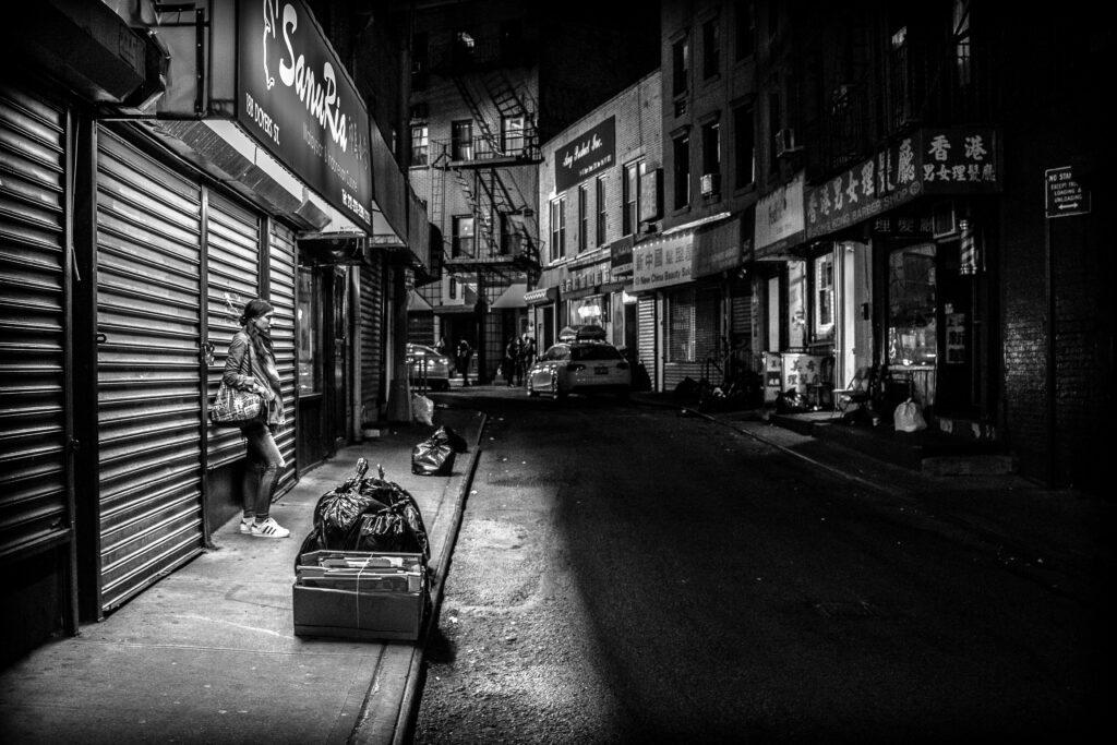 grungy street photo chinatown new york black and white