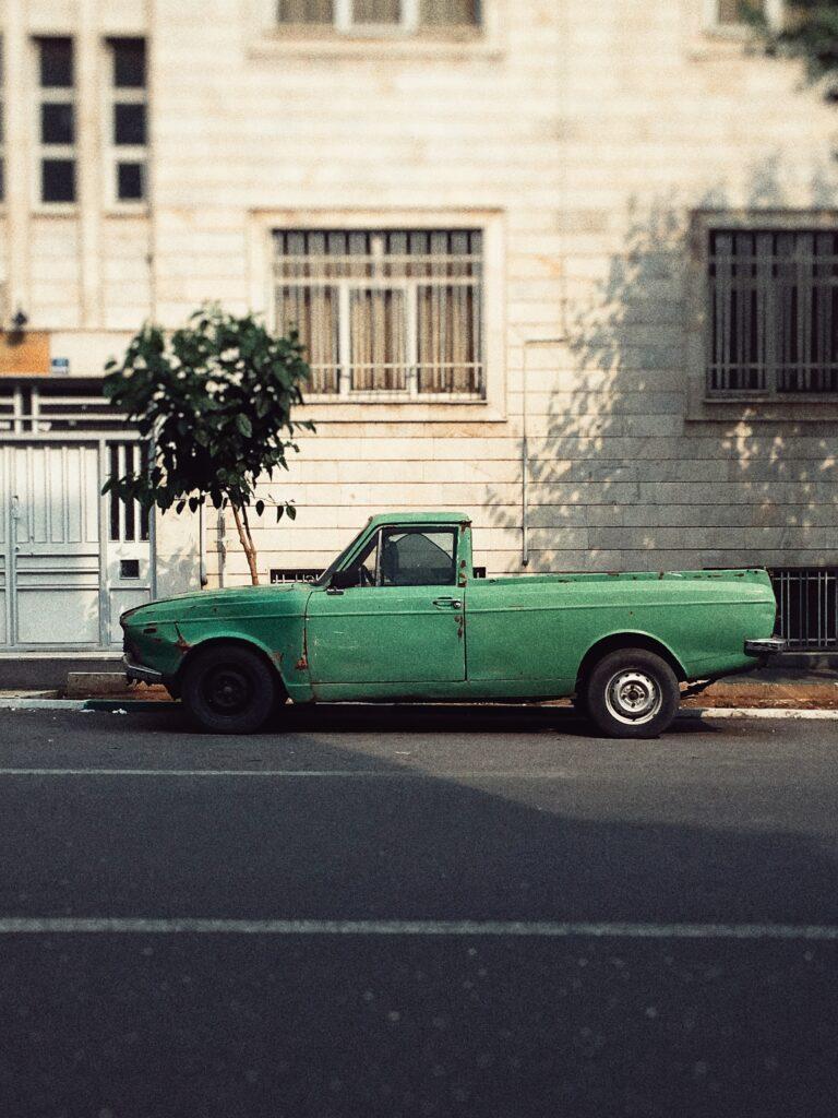 grungy street photo old green pickup truck tehran iran